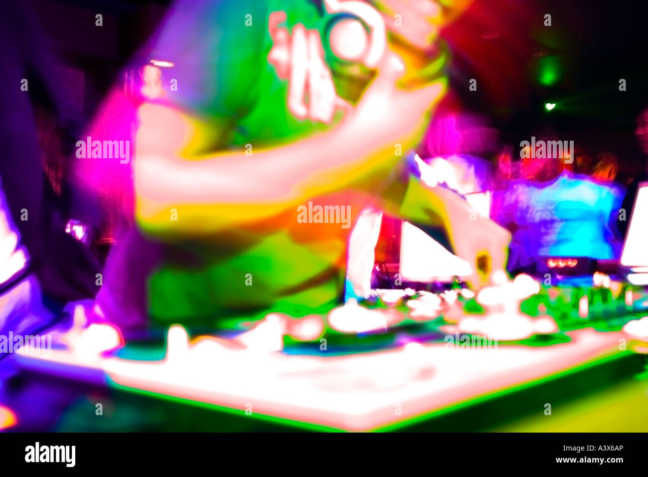 Crazy Experimental Image of a DJ Mixing in a Night Club. Bright Saturated Colours (Colors). - Stock Image