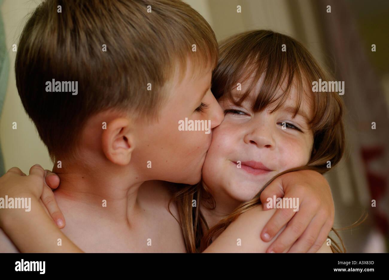 Boy Kissing A Girl On The Cheek Stock Photo 2025532 - Alamy-3533