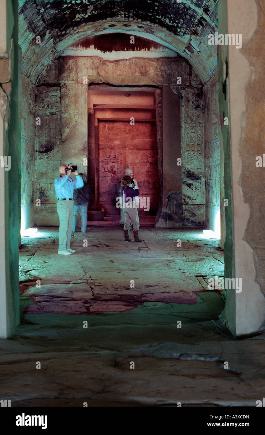 White caucasian tourists inside the Temple of Abydos in Egypt One is making a video with a camera - Stock Image