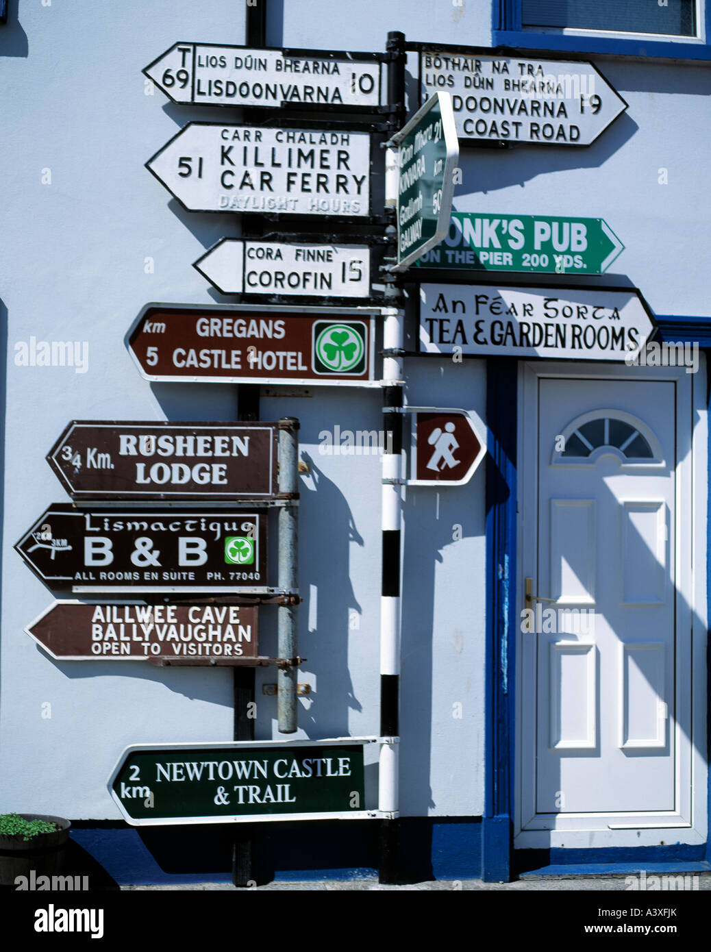 ballyvaughan village, county galway, ireland, road signs direction s in the west of ireland, non western script, - Stock Image