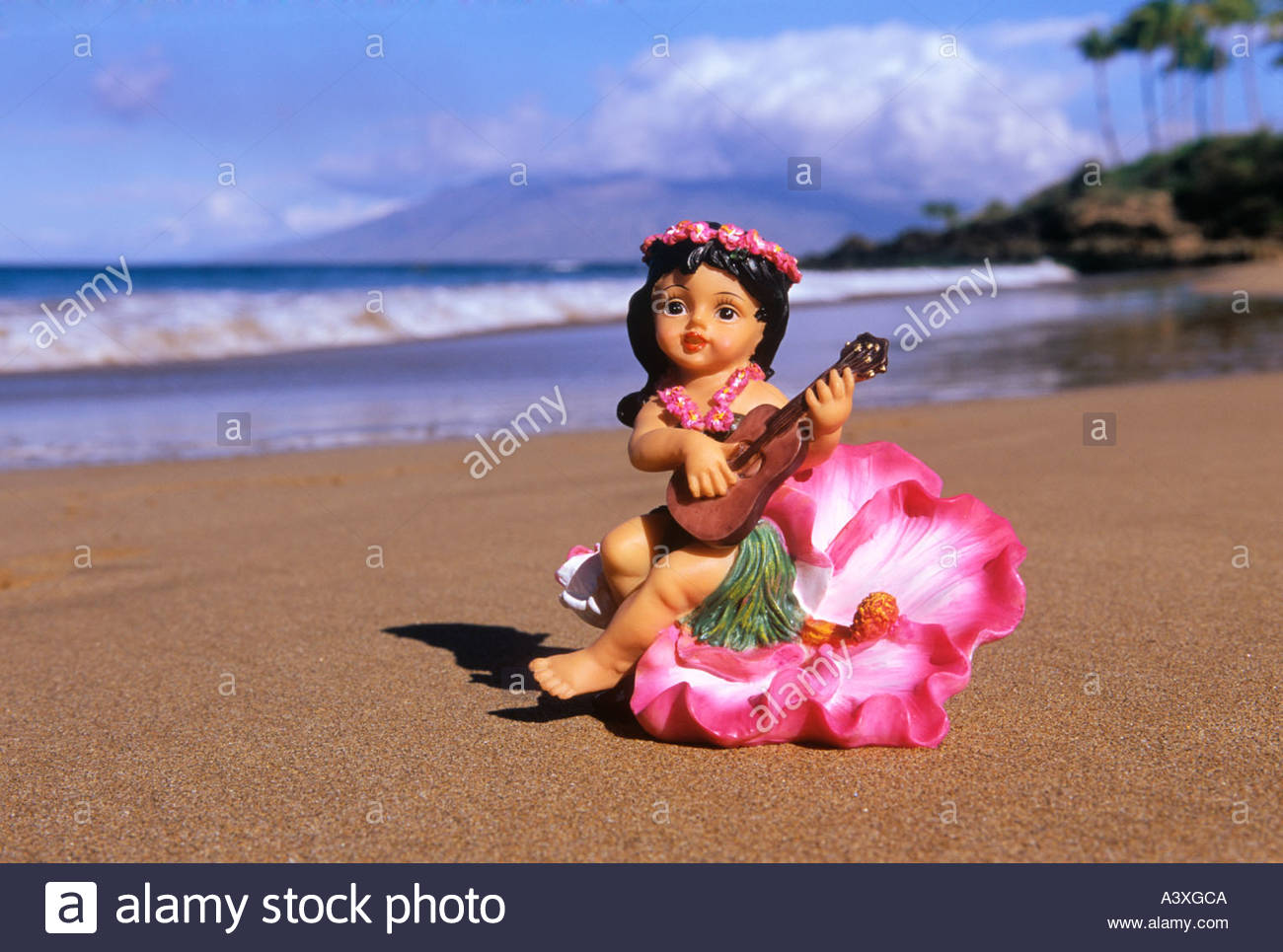 Figurine of Hula dancer with ukelele on beach at Wailea on the island of Maui in the state of Hawaii USA - Stock Image