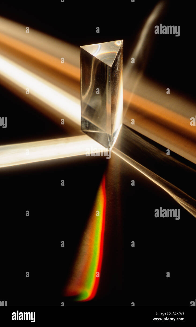 Triangular Dispersive Prism Breaking Light Into its Constituent Spectral Colors - Stock Image