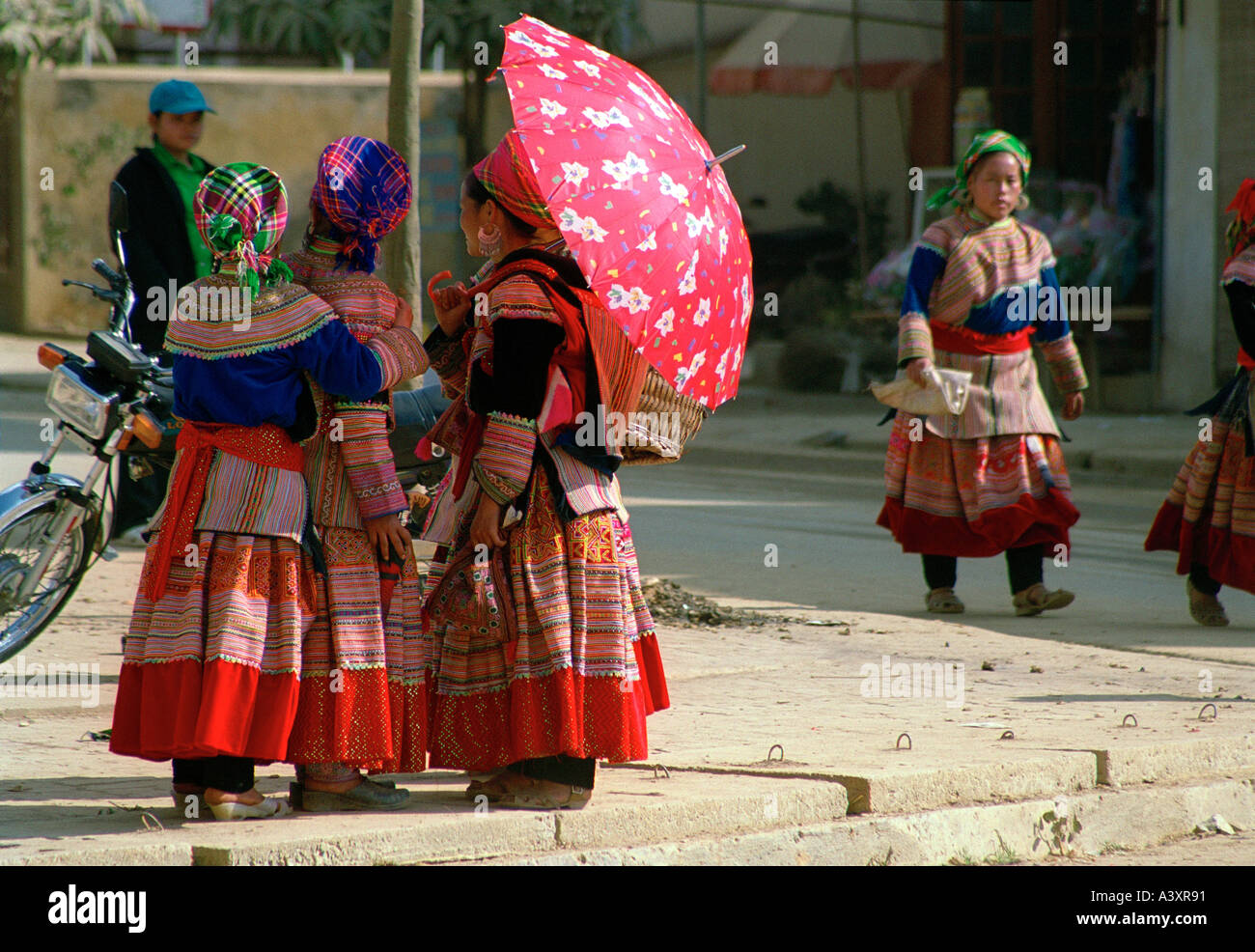 Women of the Hmong Tribe in traditional dress at the market in BacHa Northern Vietnam - Stock Image
