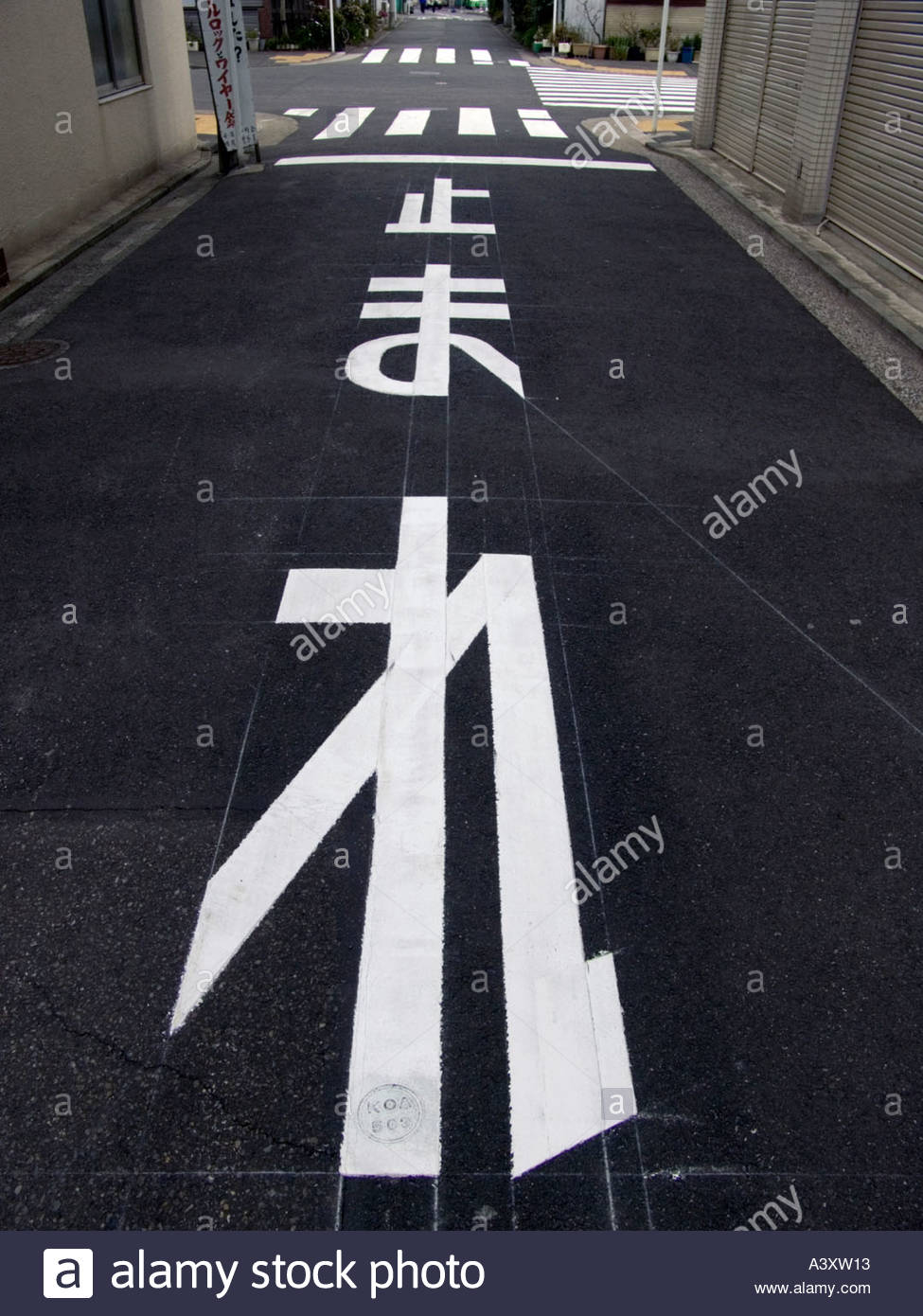 ea5636cec46 Japan STOP traffic sign freshly painted on the road Stock Photo ...