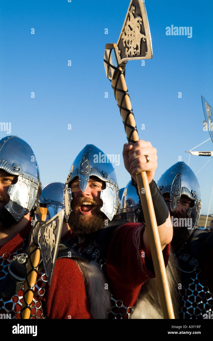 dh Up Helly Aa procession LERWICK SHETLAND Guizer Jarl Einar of Gullberuviks Viking cheering with axe - Stock Image
