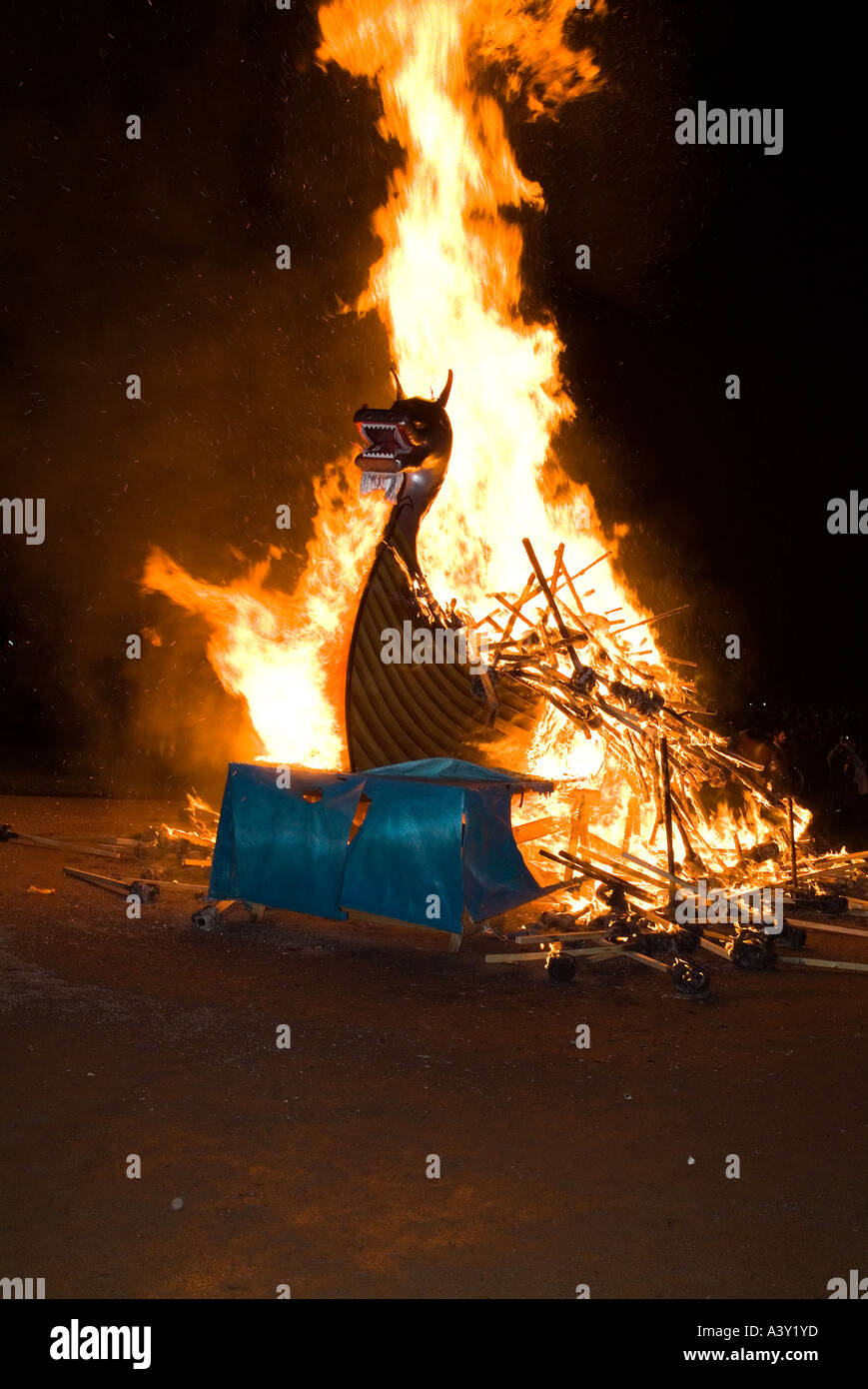 dh Up Helly Aa fire procession LERWICK SHETLAND Viking longship galley Moogi alight at burning site festival - Stock Image