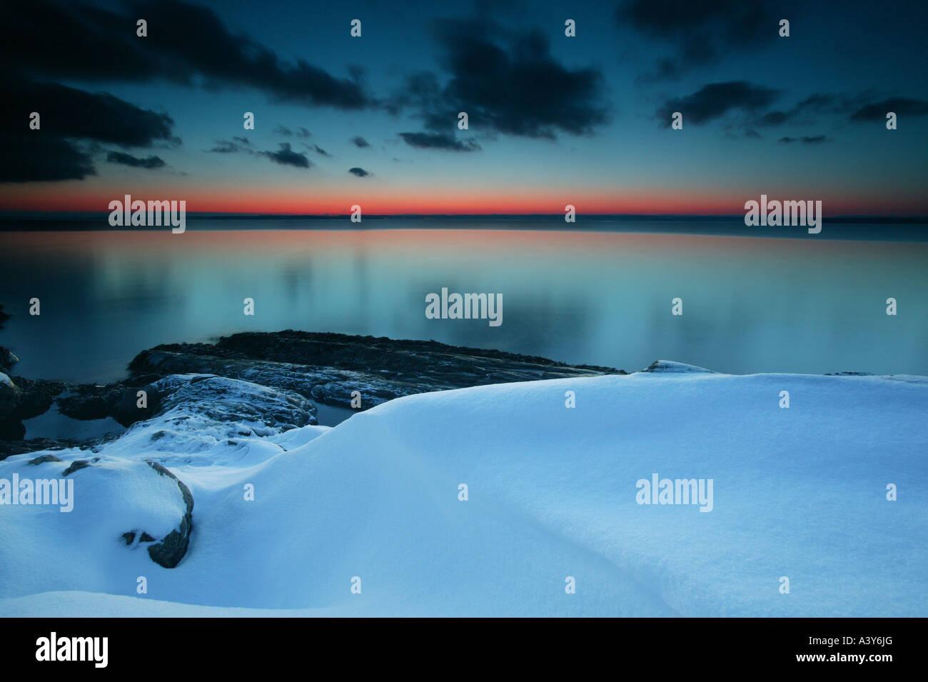 Coastal winter landscape after dark at Larkollen in Rygge kommune, Østfold fylke, Norway. Stock Photo