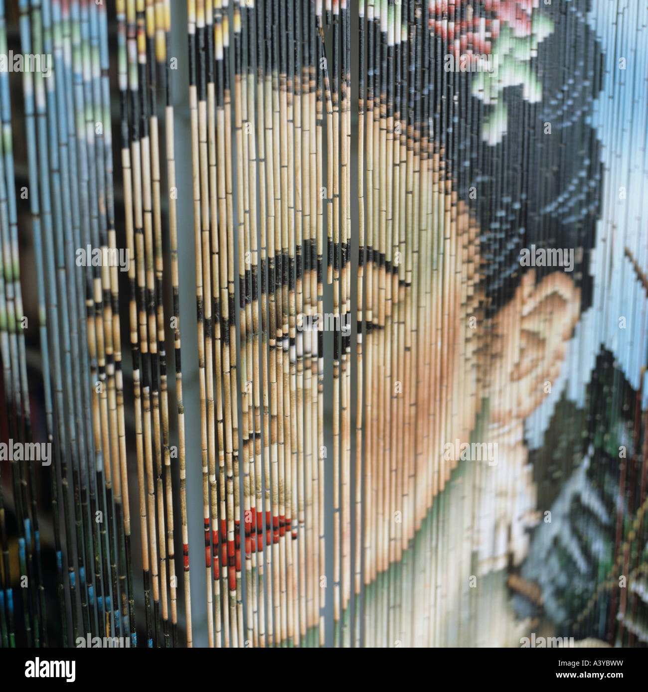 a beaded curtain with the portrait of Mexican painter Frieda Kahlo on it - Stock Image