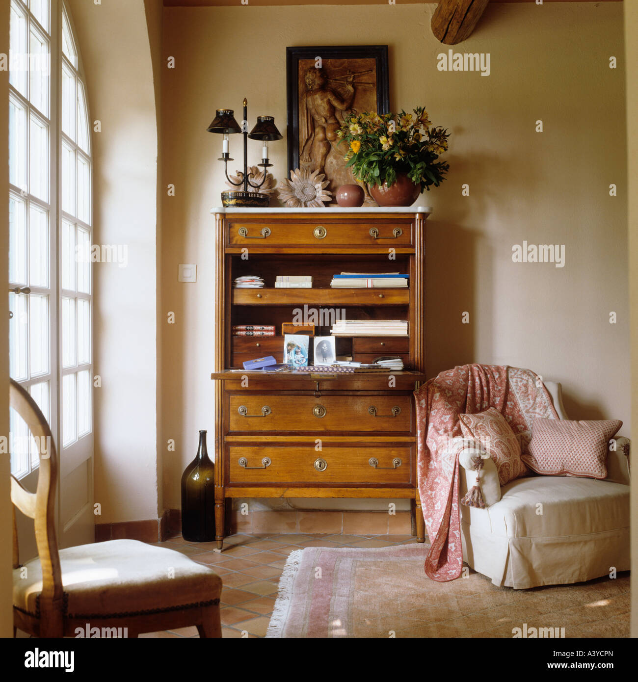 A secretaire or writing bureau with armchair in a French house - Stock Image