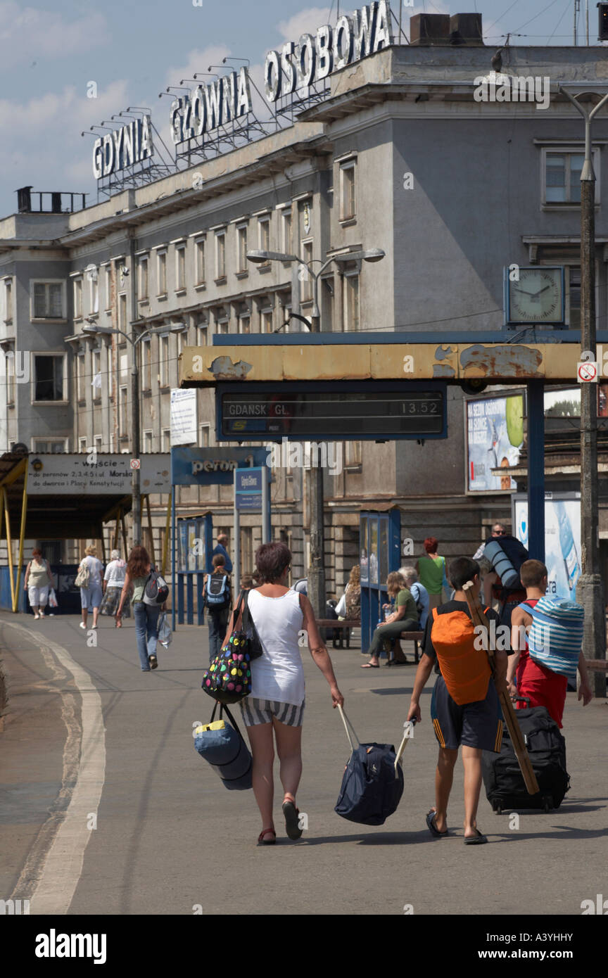 Two women arriving at Gdynia station with luggage - Stock Image