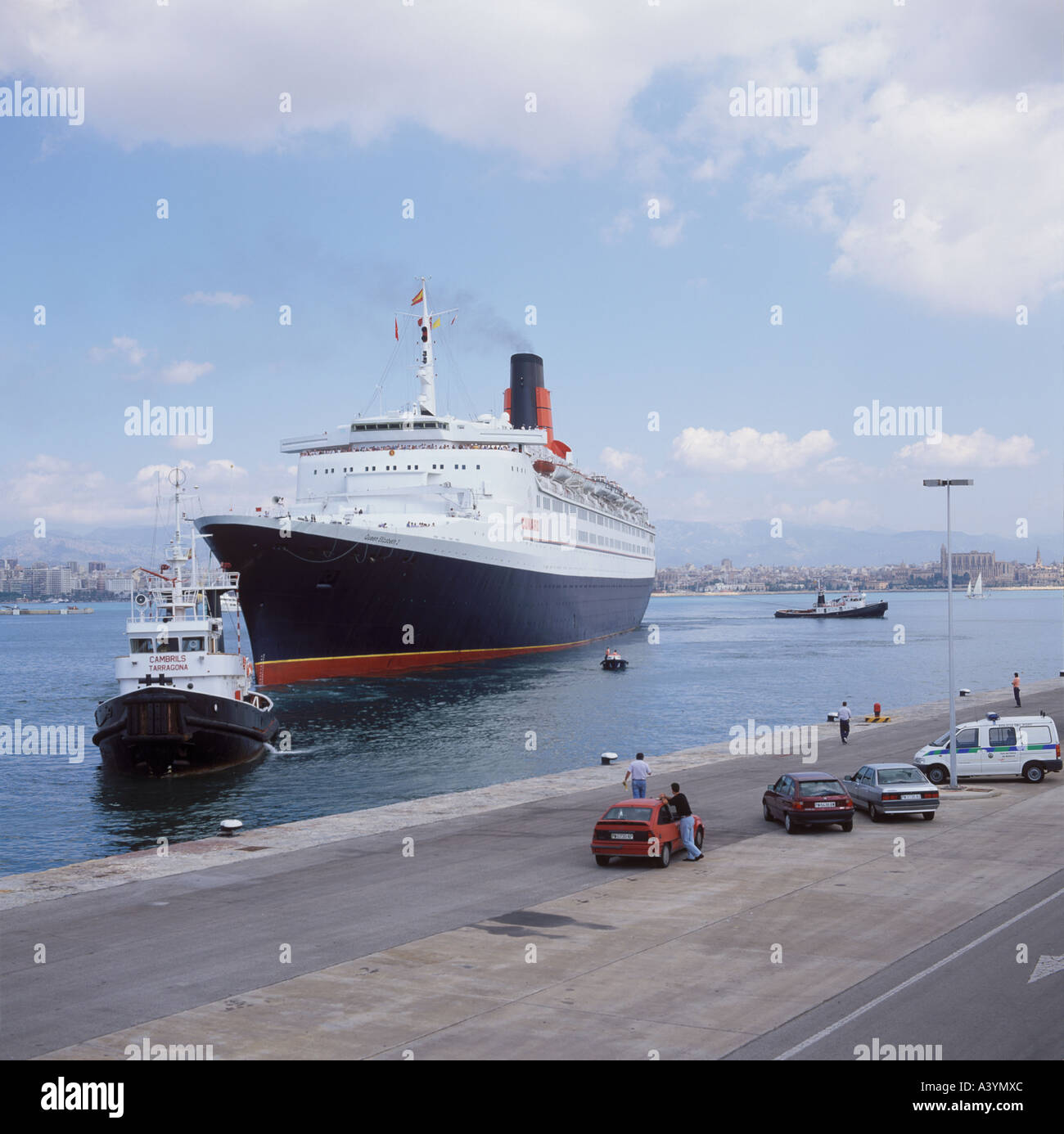Cunard cruise liner QE2 arriving at Dique del Oeste in the Port of Palma de Mallorca Baleares Spain - Stock Image
