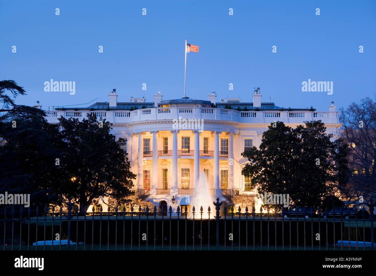 Washington White House Washington DC with the Truman Balcony at night. South side view over the fence. - Stock Image