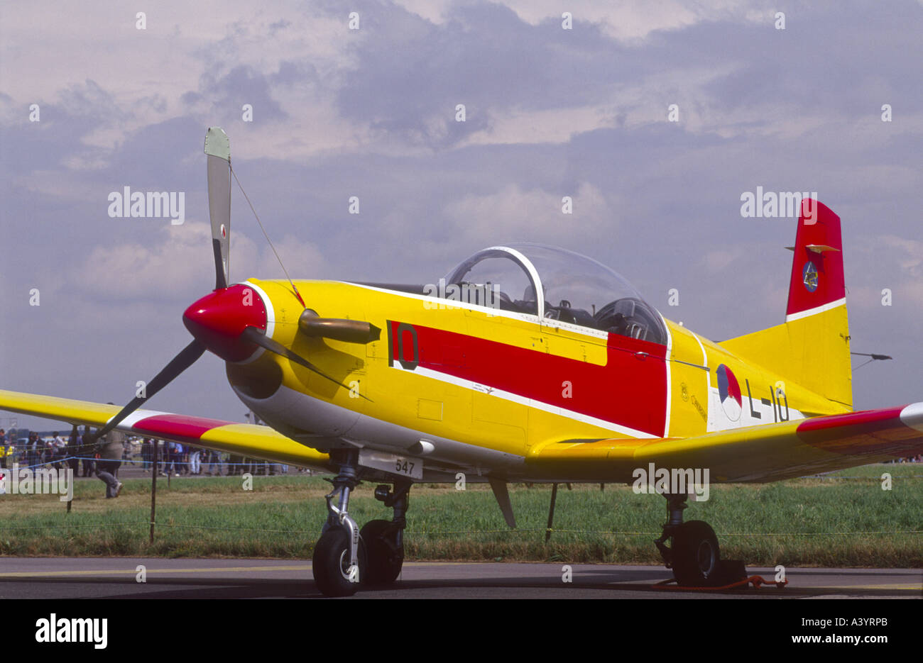 Pilatus PC-7 Turbo painted High Visibility Yellow with Red and White Striping.   GAV 2254-229 - Stock Image