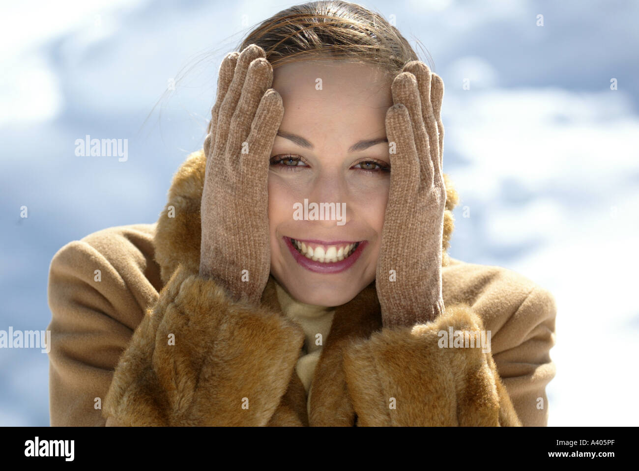 e8a71a6c5d118 elegant young woman wearing winter coat fur scarf and gloves - Stock Image