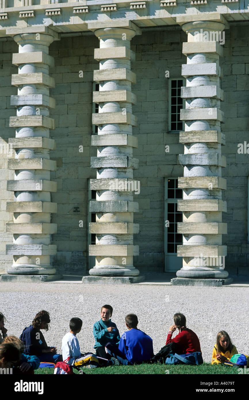 FRANCE JURA  ARC-ET-SENANS   SALINE ROYALE  ROYAL SALTWORKS VISITING SCHOOLCHILDREN IN FRONT OF DIRECTOR'S HOUSE - Stock Image