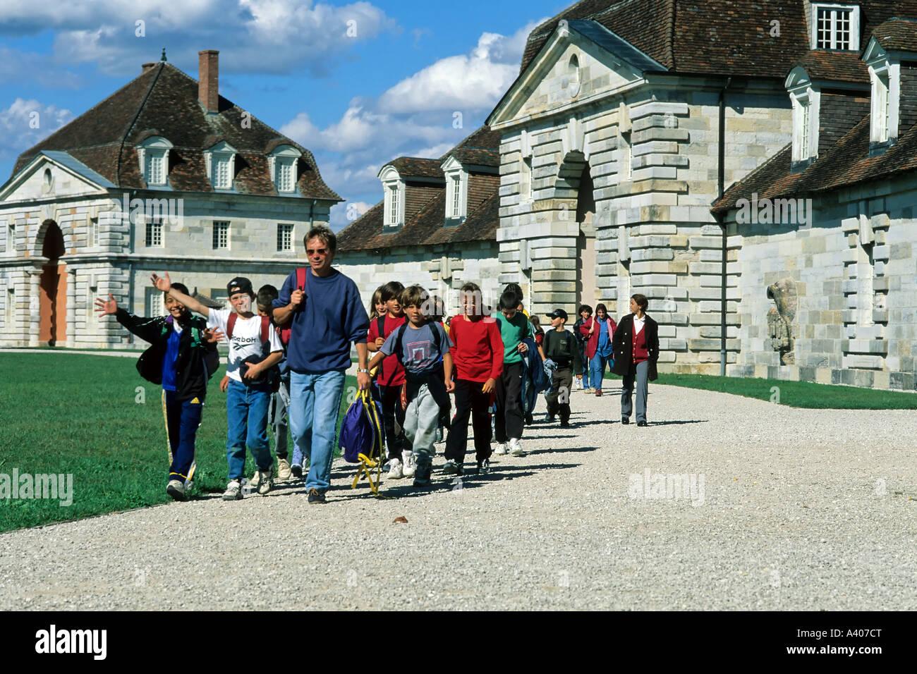 FRANCE JURA  ARC-ET-SENANS   SALINE ROYALE  ROYAL SALTWORKS GROUP OF VISITING SCHOOLCHILDREN - Stock Image