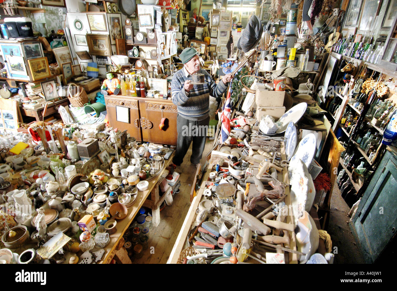 Old man with the thousands of possessions he has hoarded over many decades of never throwing anything away. - Stock Image