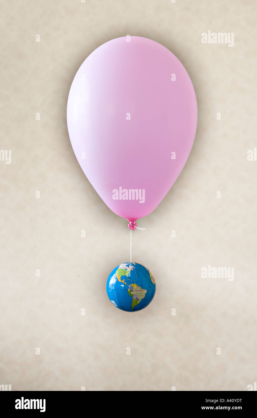 Inflated balloon with globe - Stock Image