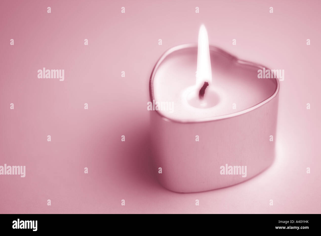 Heart shaped candle - Stock Image