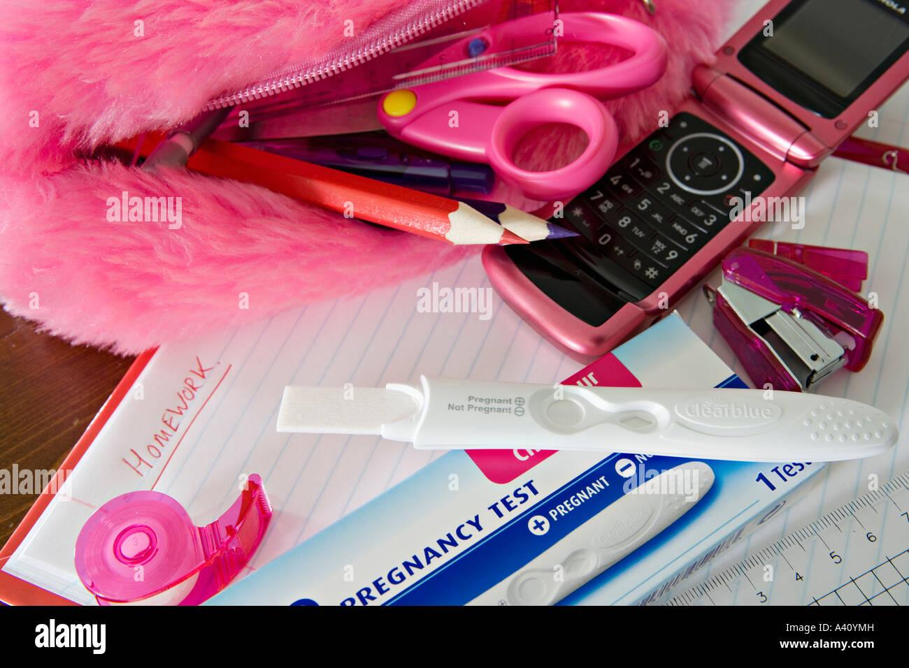 Pregnancy testing kit amongst contents of schoolgirl pencil case - Stock Image