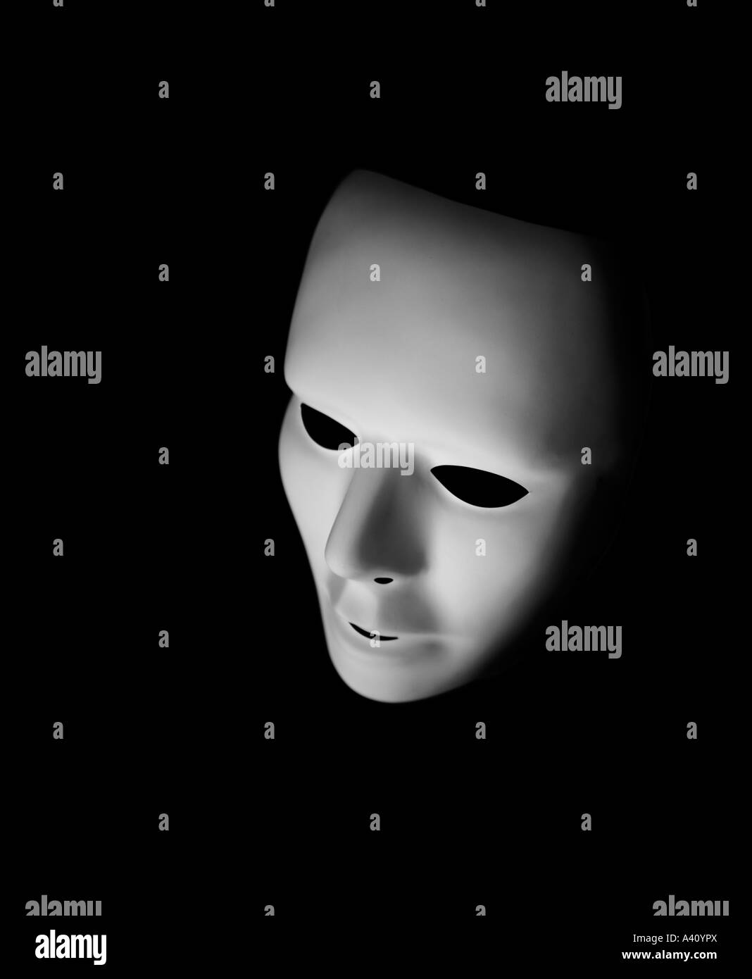 Costume mask photographed in moody lighting mystery - Stock Image