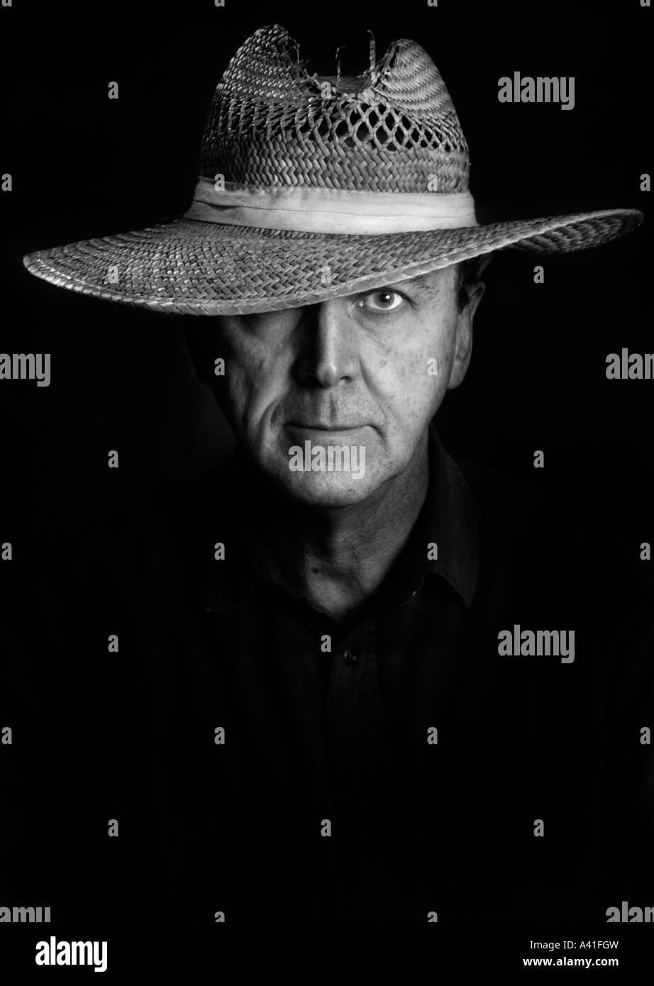 Black White Portrait of a man in a straw fishing hat or straw farmers hat or straw utility hat It s a man in a hat - Stock Image