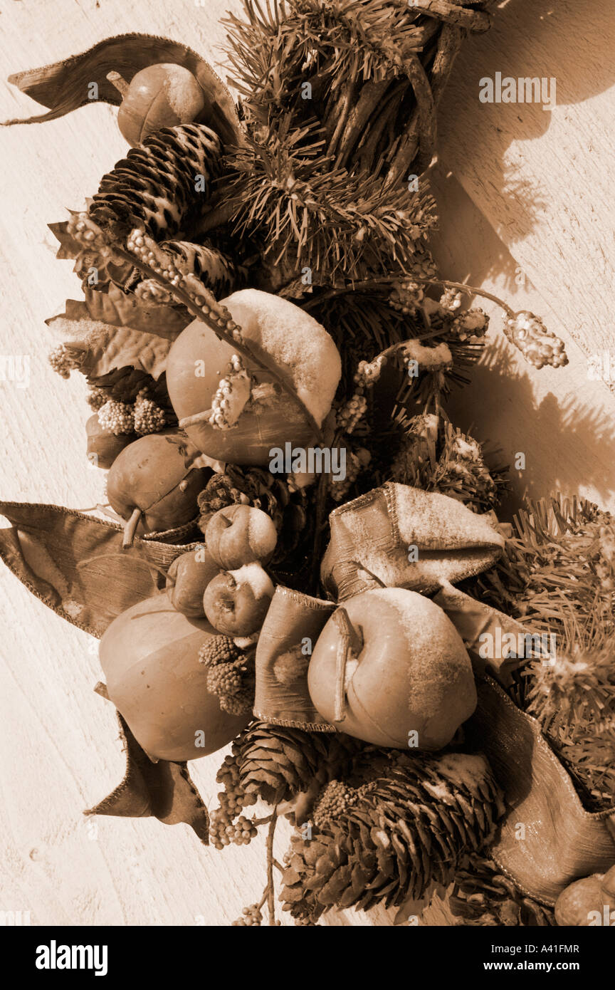 Christmas Wreath powdered with new snow and rendered in sepia tones - Stock Image