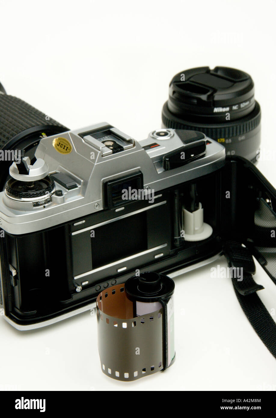 Old SLR film camera open with film. - Stock Image