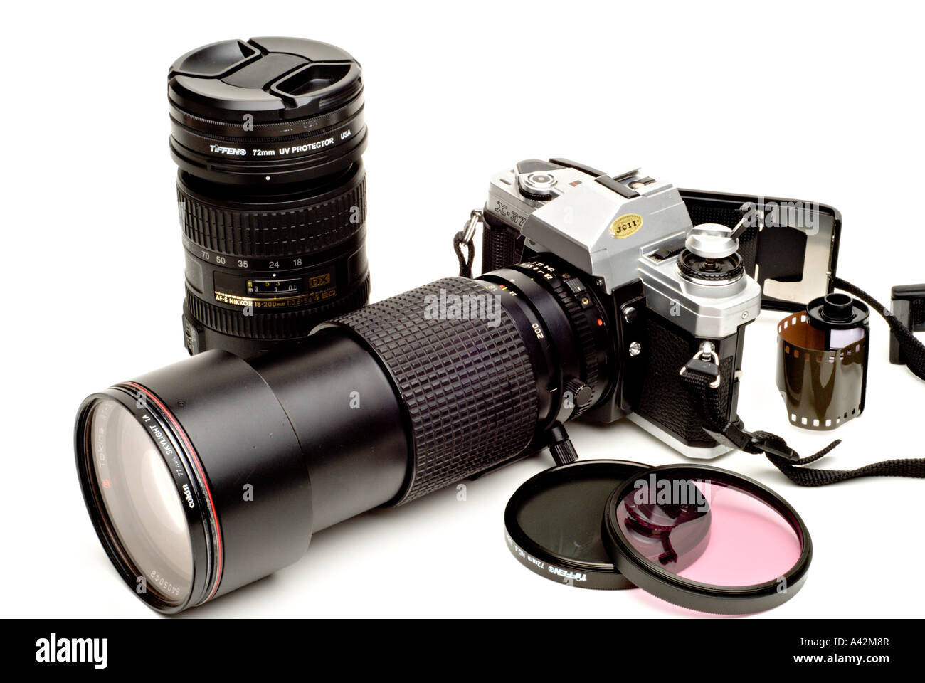 Old SLR camera with film lenses and filters - Stock Image