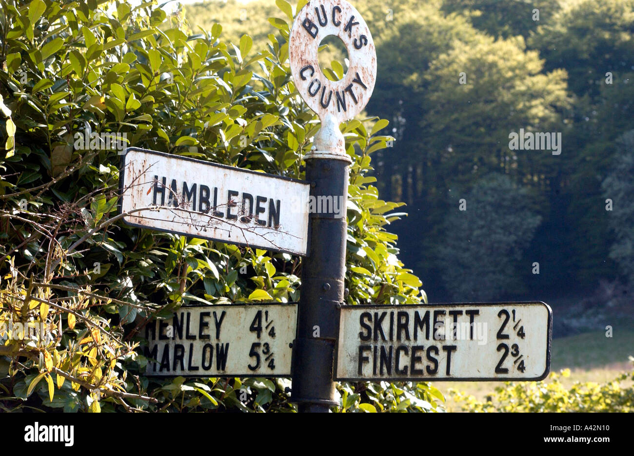 Sign pointing along a country lane in Buckinghamshire towards Hambleden village. - Stock Image