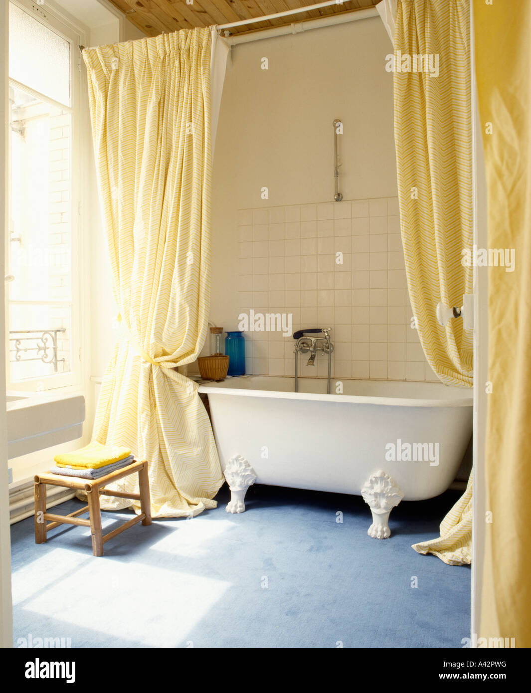 Bathroom With Freestanding White Clawfoot Bath And Yellow