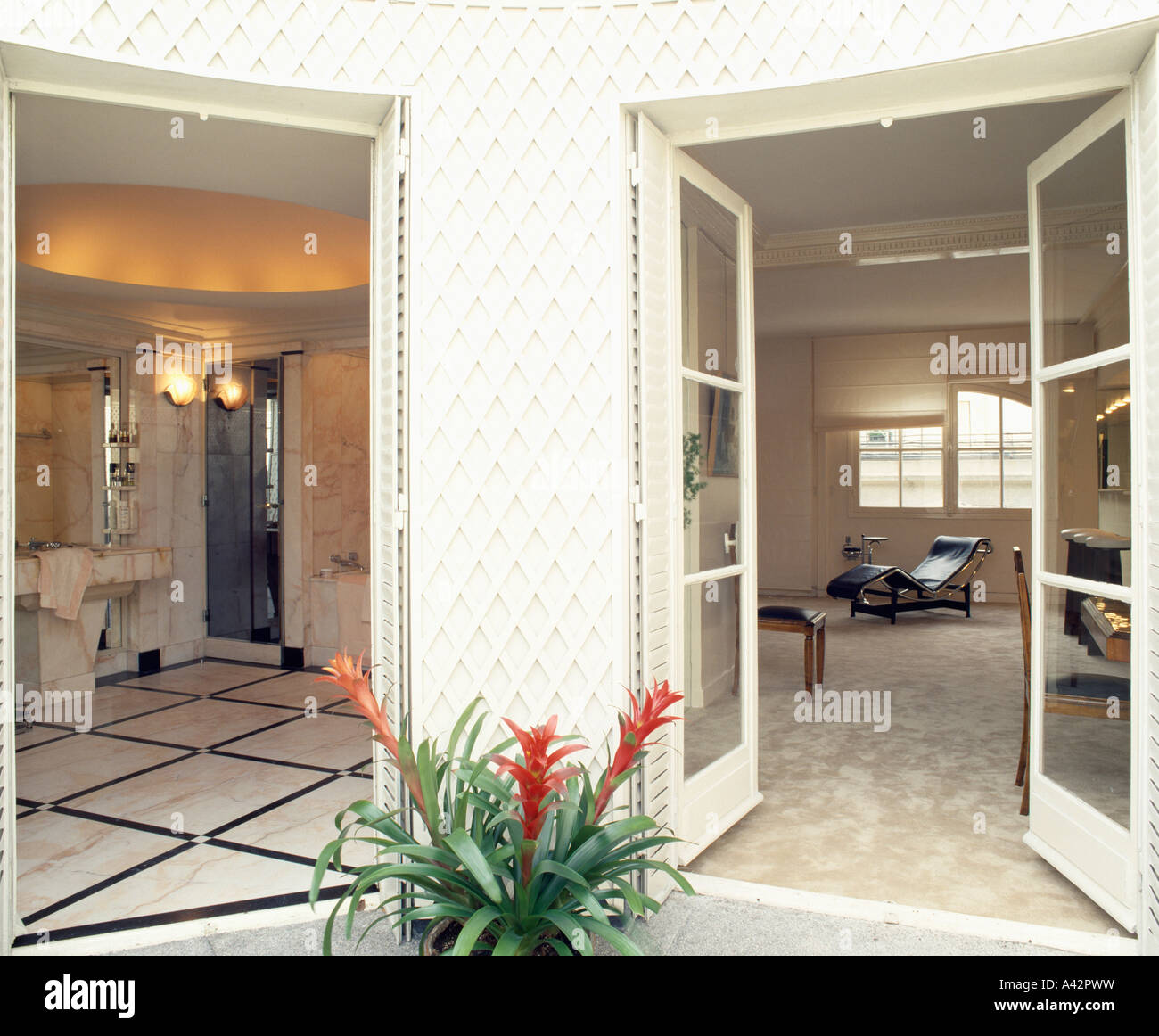 Open glazed double doors with view of bathroom and living-room in ...