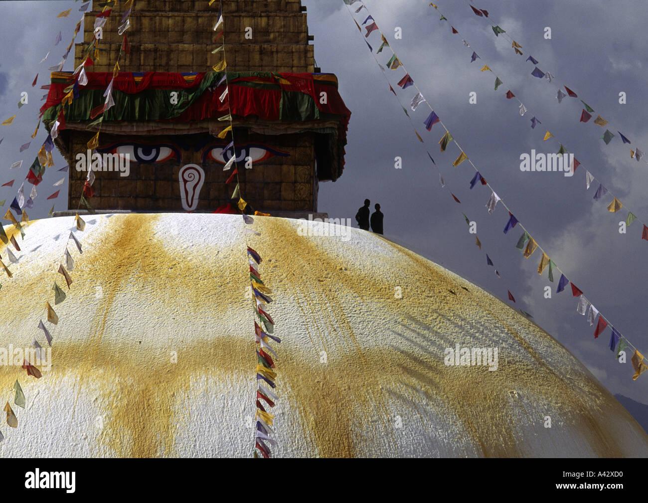 Two men standing on Boudhanath Stupa Katmandu Nepal - Stock Image
