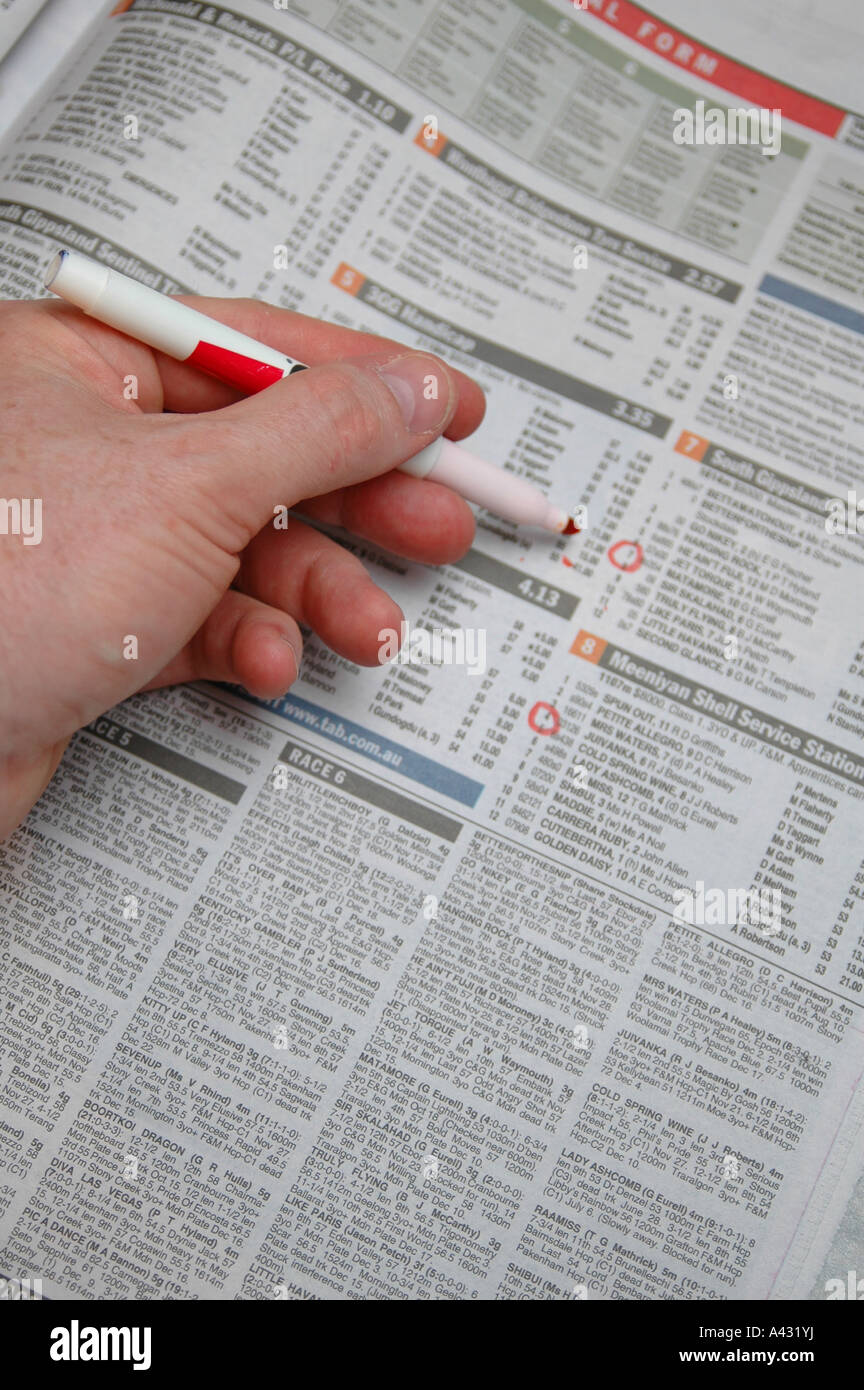 Marking selections on a Horse Racing form guide Stock Photo ...