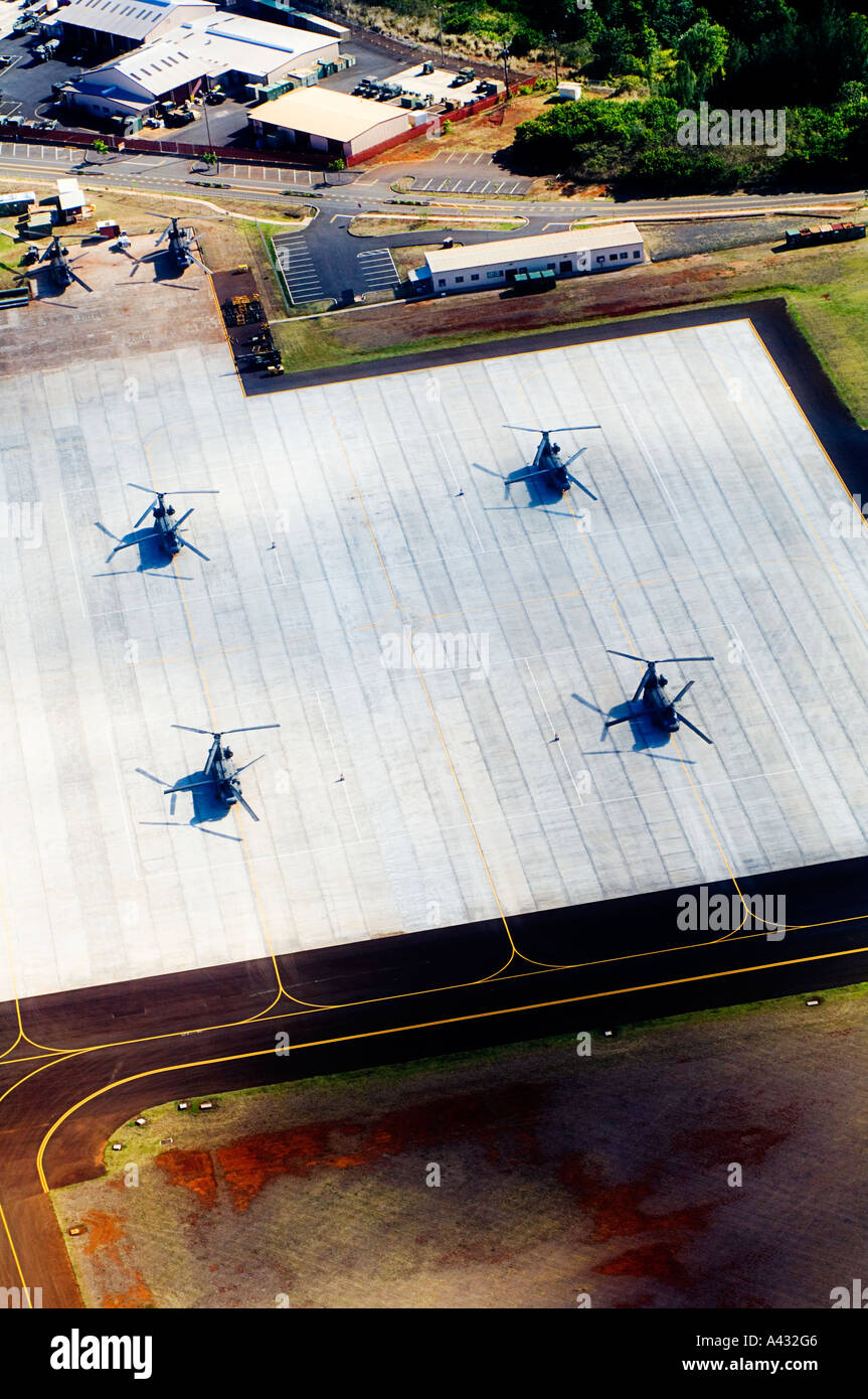 Four helicopters on a pad on the island of Hawaii aerial view - Stock Image