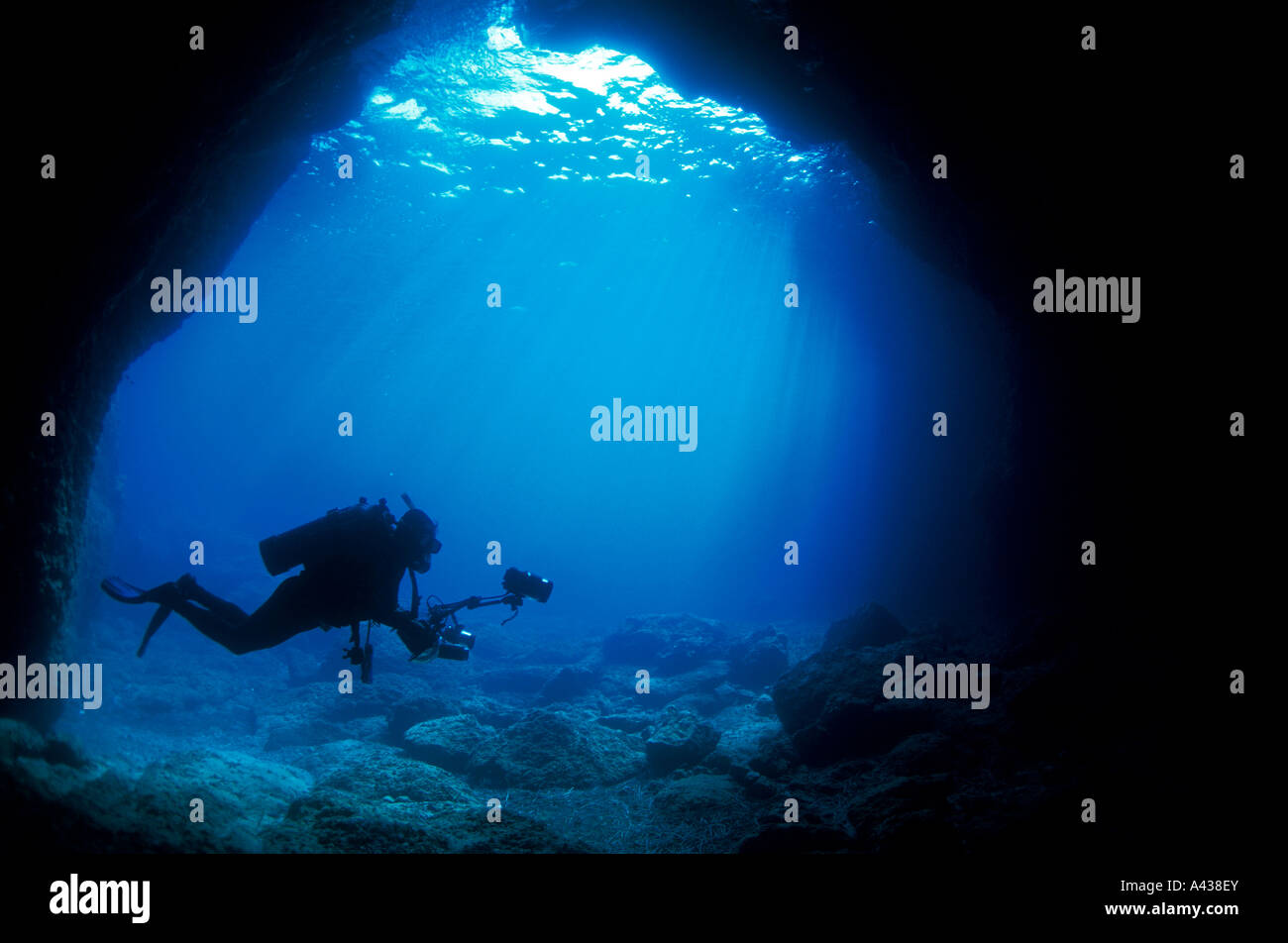 Underwater photographer at the entrance of a marine cave, Fethiye Turkey. - Stock Image
