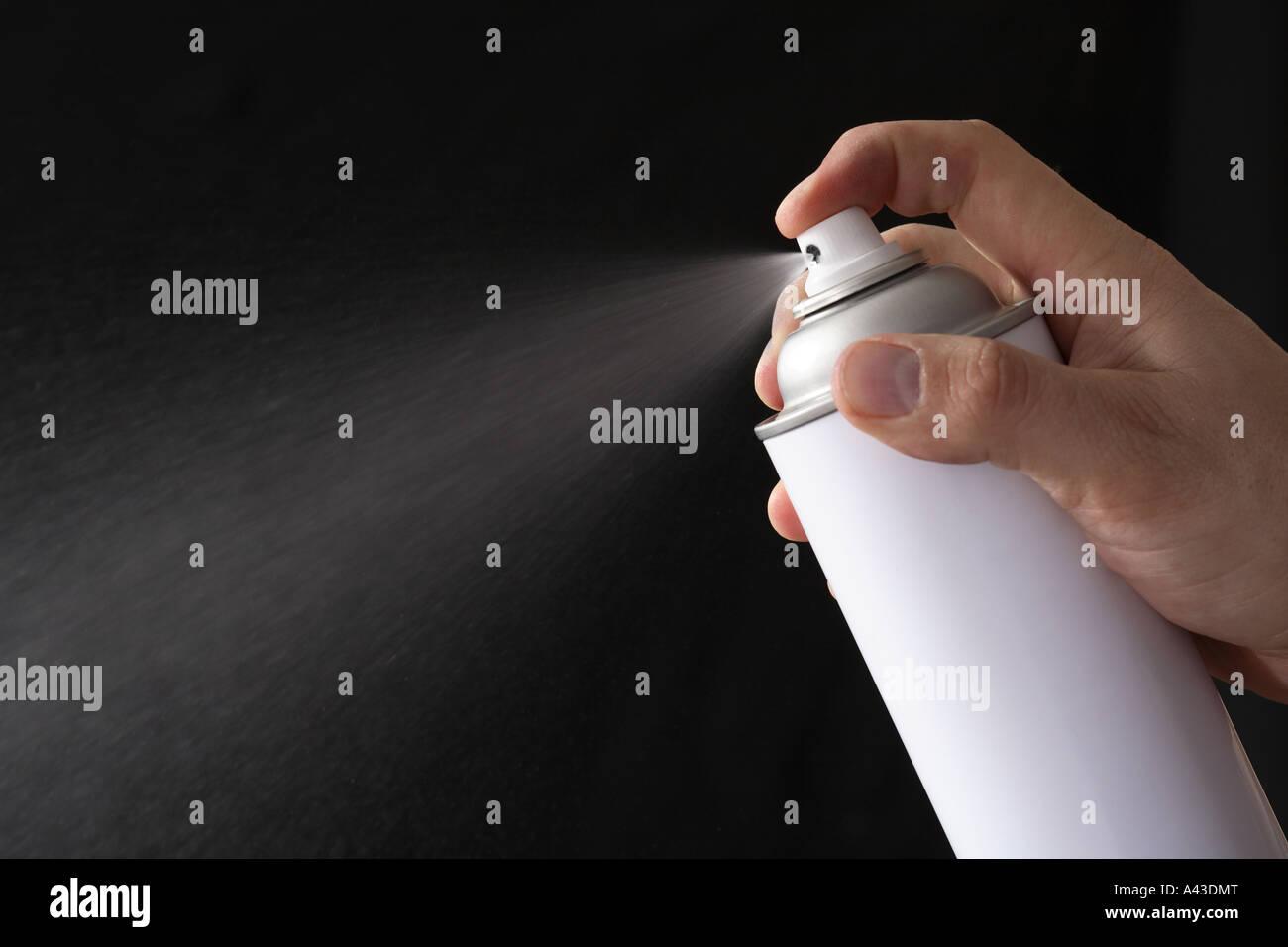 Spraying an aerosol can - Stock Image