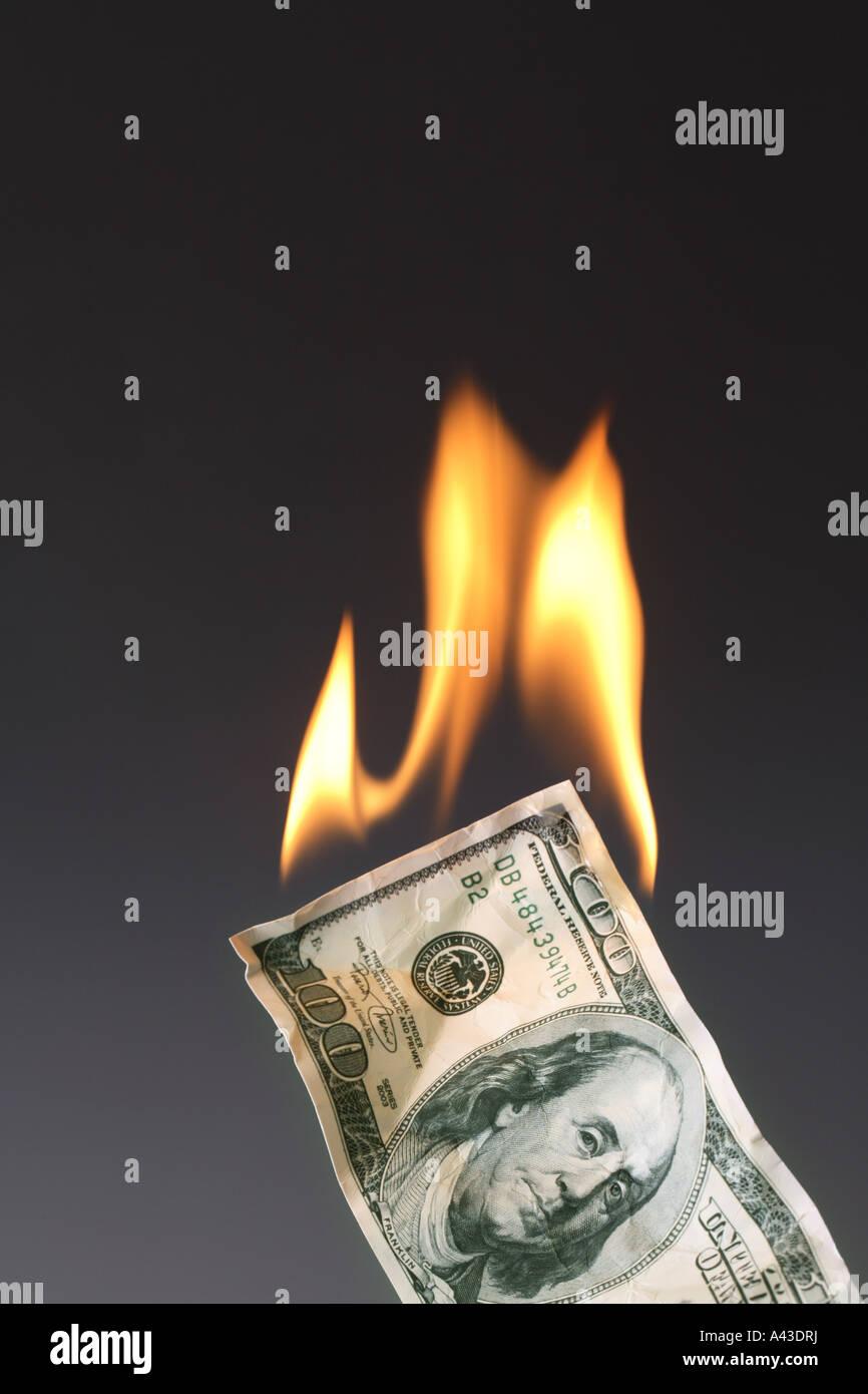 Burning One Hundred Dollar Bill - Stock Image