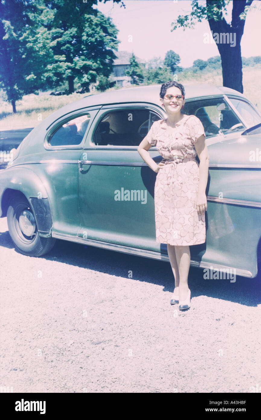 vintage 1940 s woman with green car - Stock Image