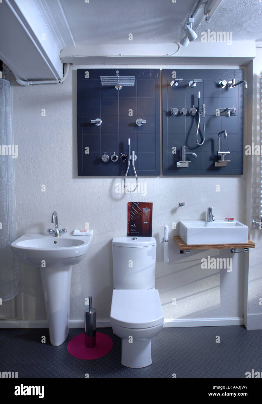 LUXURY VOLA BATHROOM FITTINGS IN THE WINDOW OF A SMALL INDEPENDENTLY OWNED BATHROOM SHOWROOM UK - Stock Image