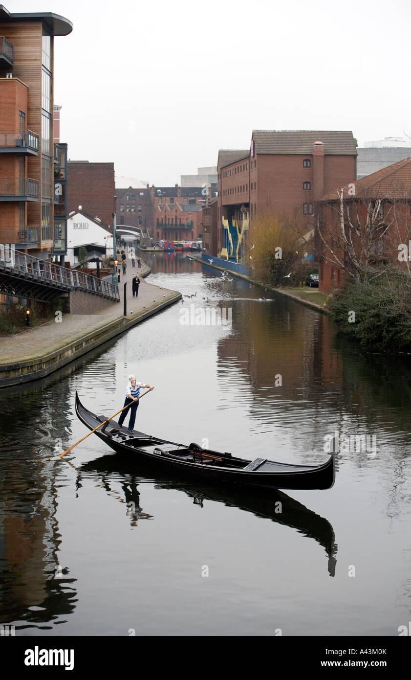 A Gondola traveling along the canal network in the centre of Birmingham West Midlands England Stock Photo