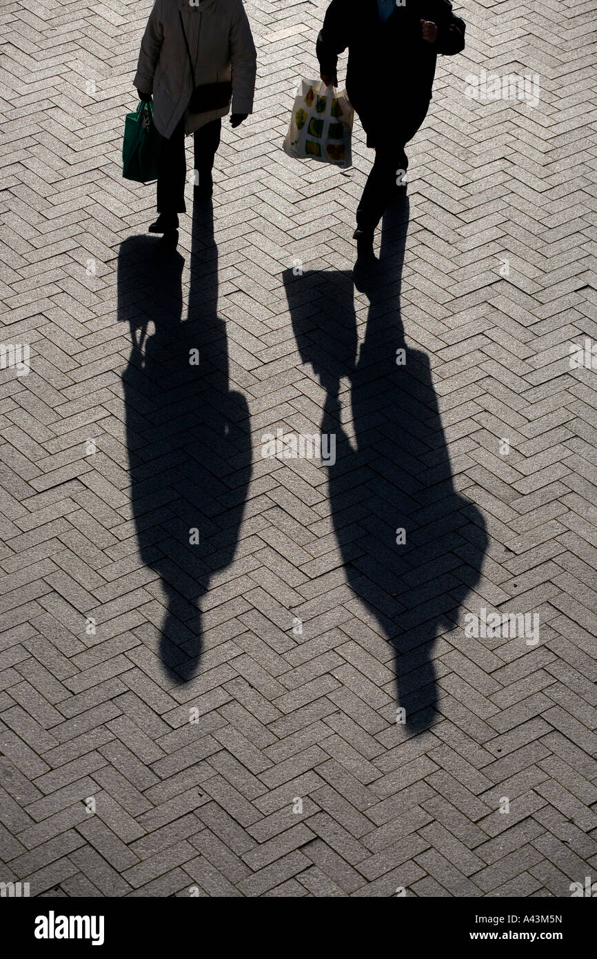 The shadow of a shopper in Bullring Shopping Centre Birmingham West Midlands England - Stock Image