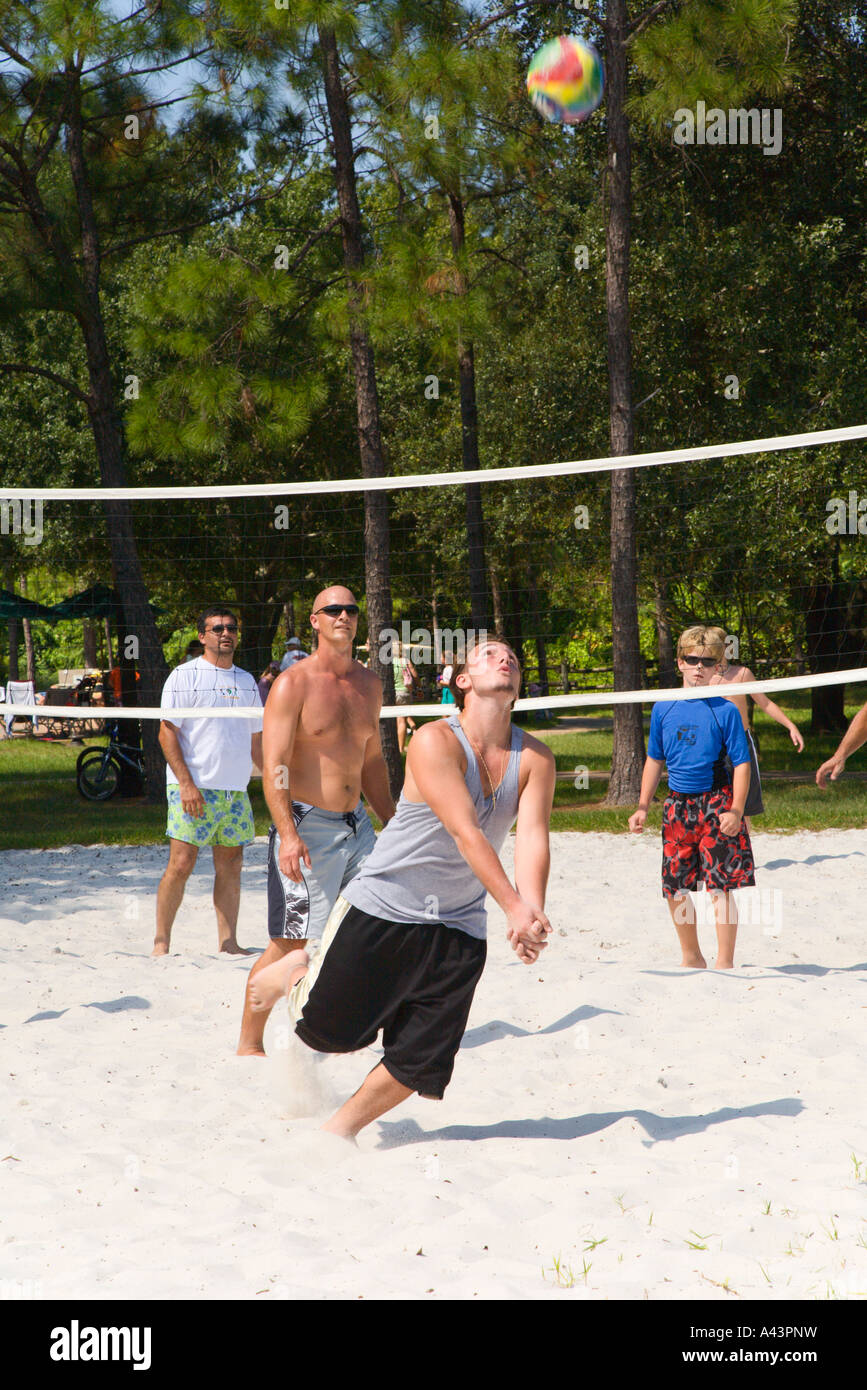 Guests play beach sand volleyball organized activity at Fort Wilderness in Walt Disney World - Stock Image