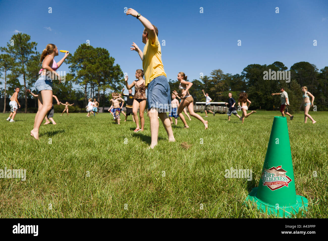 Guests play ultimate Frisbee organized activity at Fort Wilderness in Walt Disney World - Stock Image