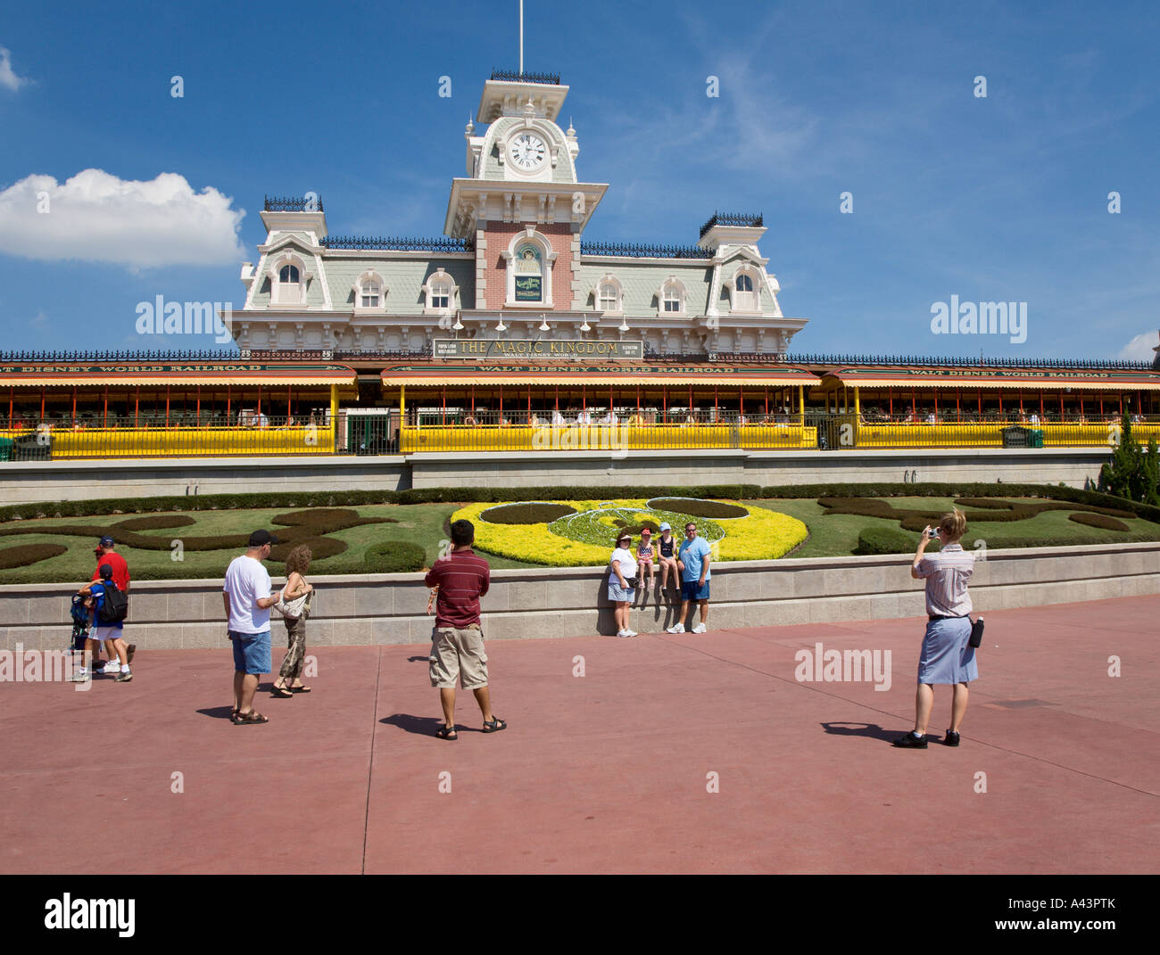 Park guests taking pictures outside entrance to the Magic Kingdom at Walt Disney World, Florida, USA - Stock Image