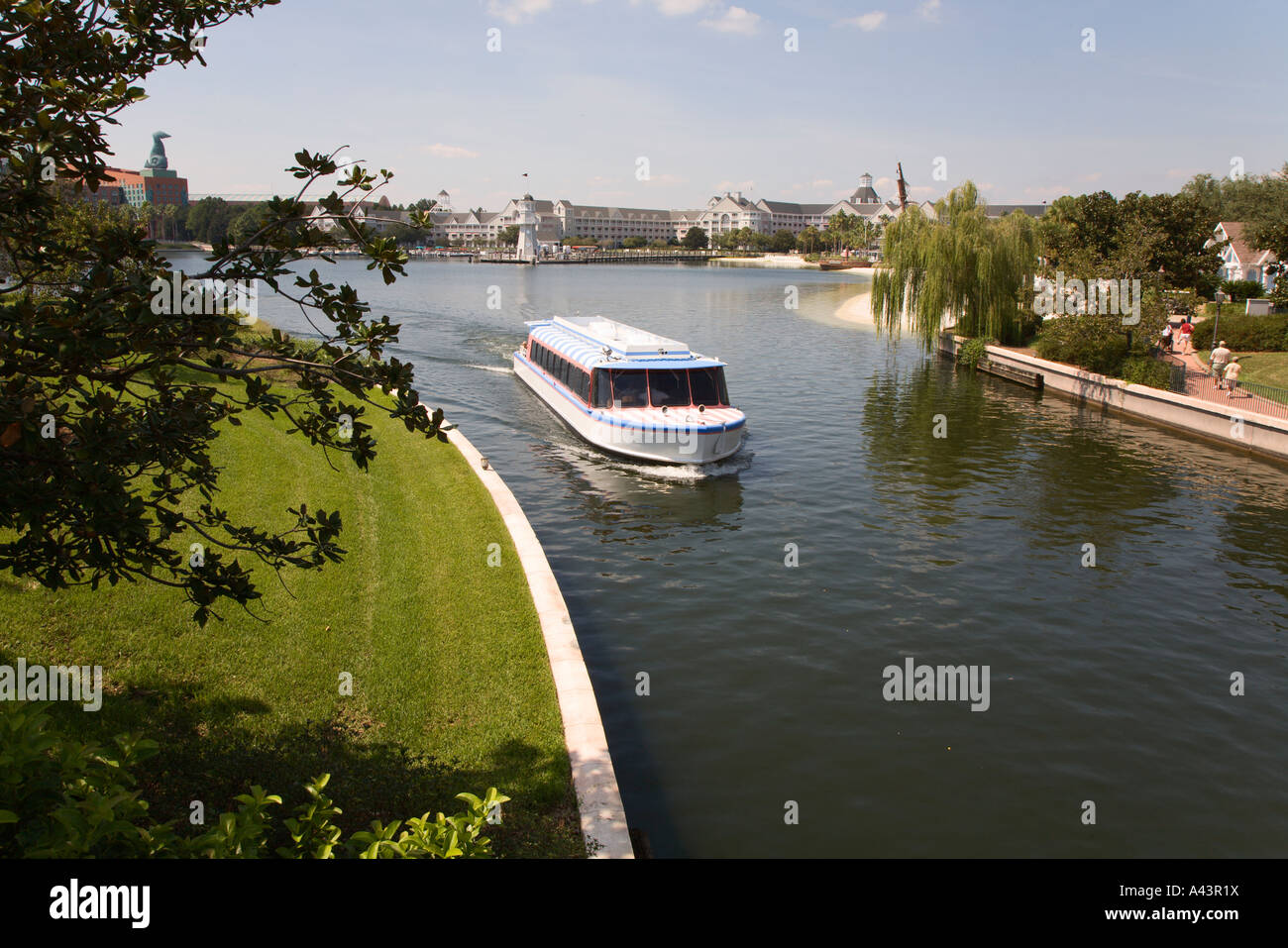 Water taxi carries park guests between parks and resorts at Walt Disney World in Florida, USA - Stock Image