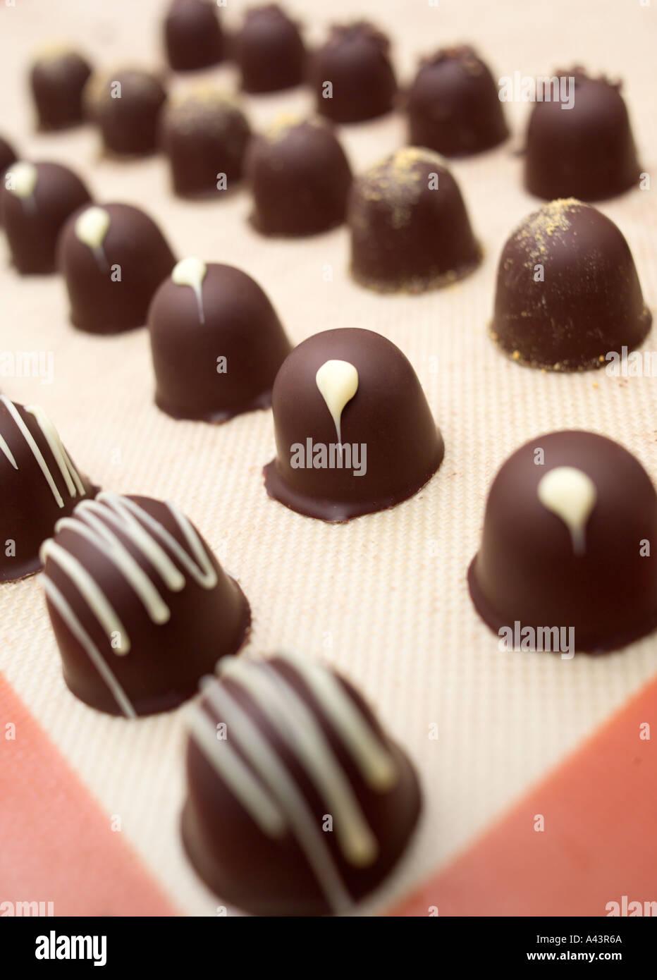 The process of making handmade chocolates - Stock Image