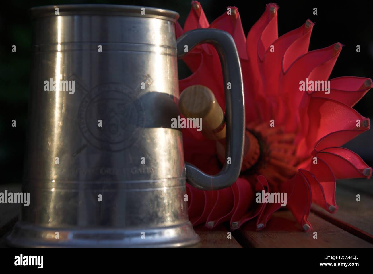 pewter mug with parasol handle - Stock Image