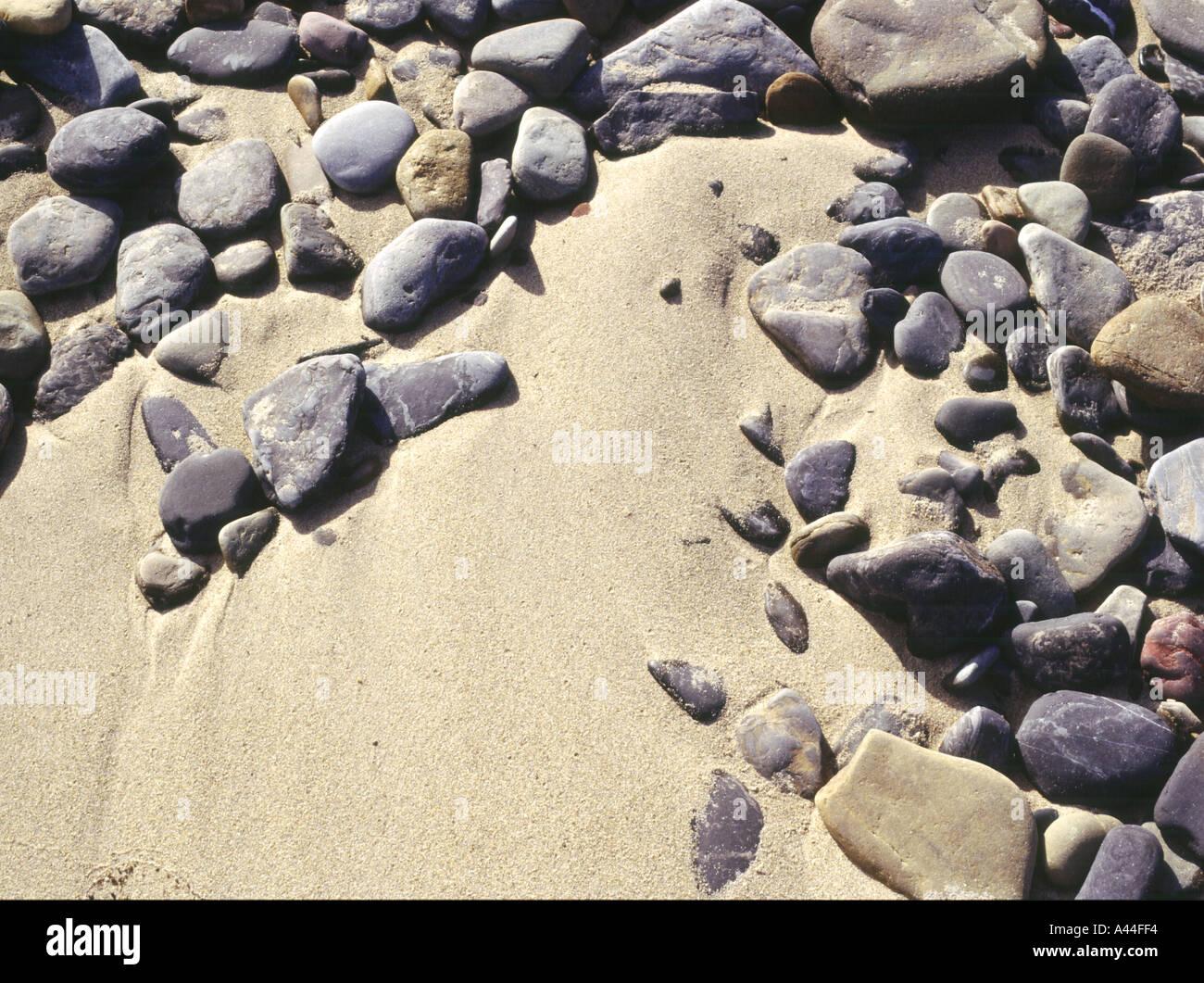 dh  SAND BACKGROUND Stone pebbles texture golden sand seashore close up textures Stock Photo