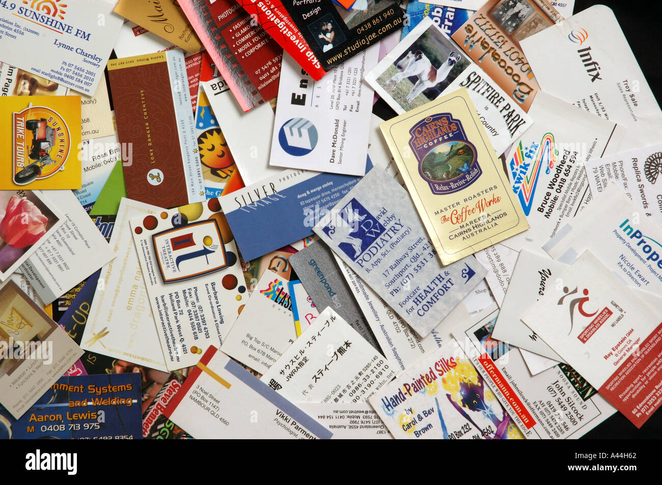 pile of mixed business cards dsca 2043